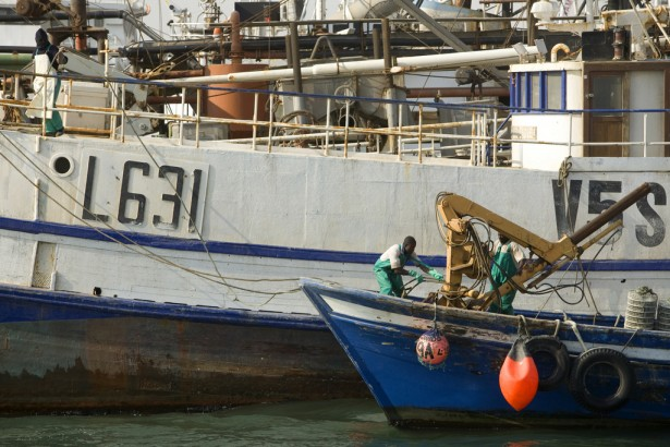 Walvis Bay on the Atlantic Ocean is the main port in Namibia and home to many fishing companies, fishing is one of the main contributors to the Namibian economy. Etale Fishing Company is one of many along the waters in Walvis Bay.A small fishing vessel docks at an adjacent quay.